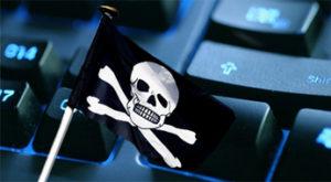 Черный флаг пирата на фоне монитора